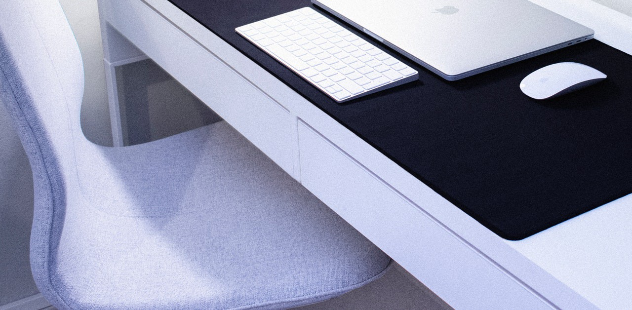 computer, keyboard, mouse at desk, with chair pulled out, ready for great writing