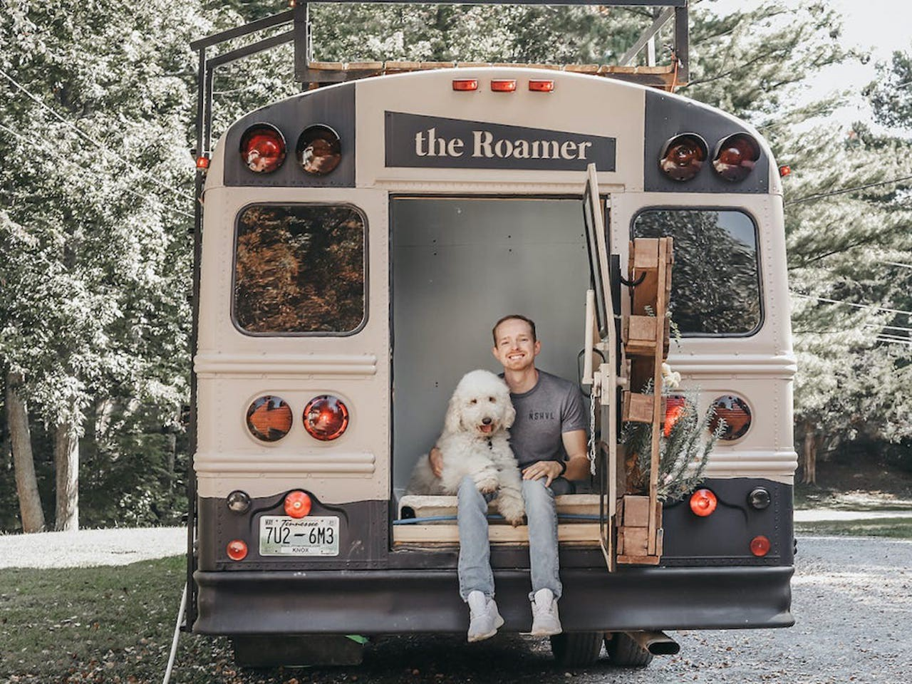 Caleb Brackney and his dog sitting in the back of the school bus.