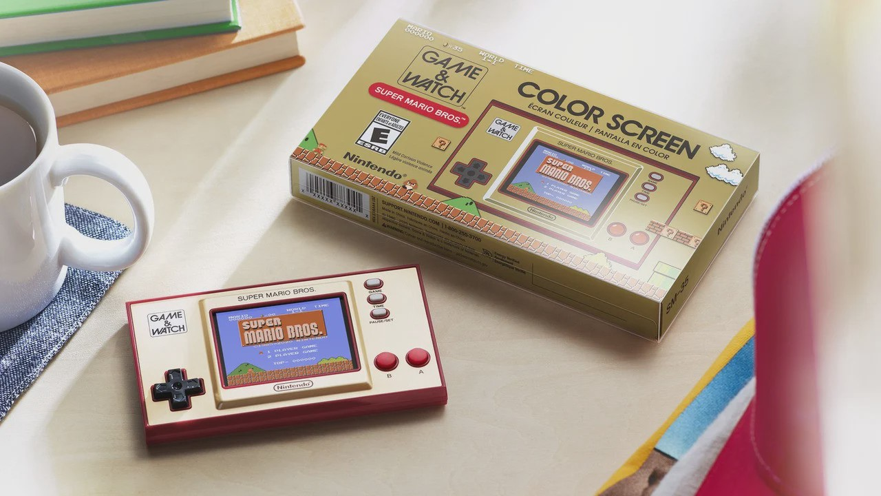 A Super Mario Bros Game and Watch handheld with a retro case referencing the old school boxes of the 80s