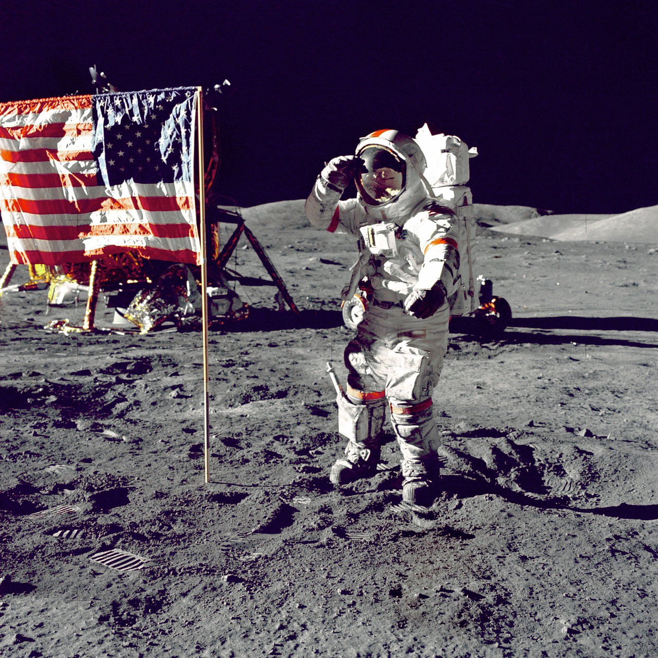Moonshot Thinking: America Puts a Man on the Moon. He is saluting next to an American Flag.