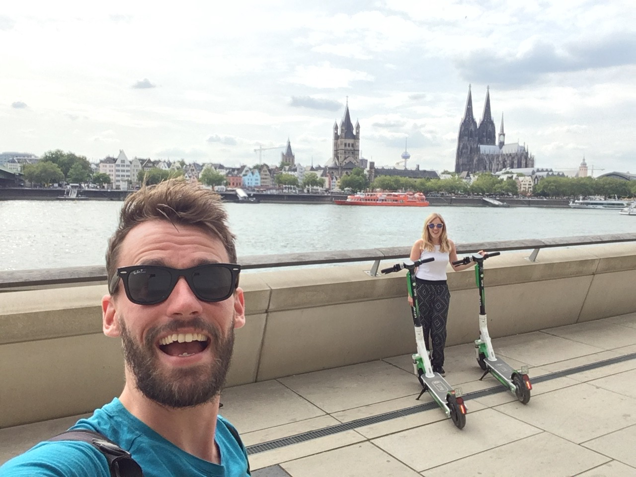 Selfie with electric scooters and Cologne in the background