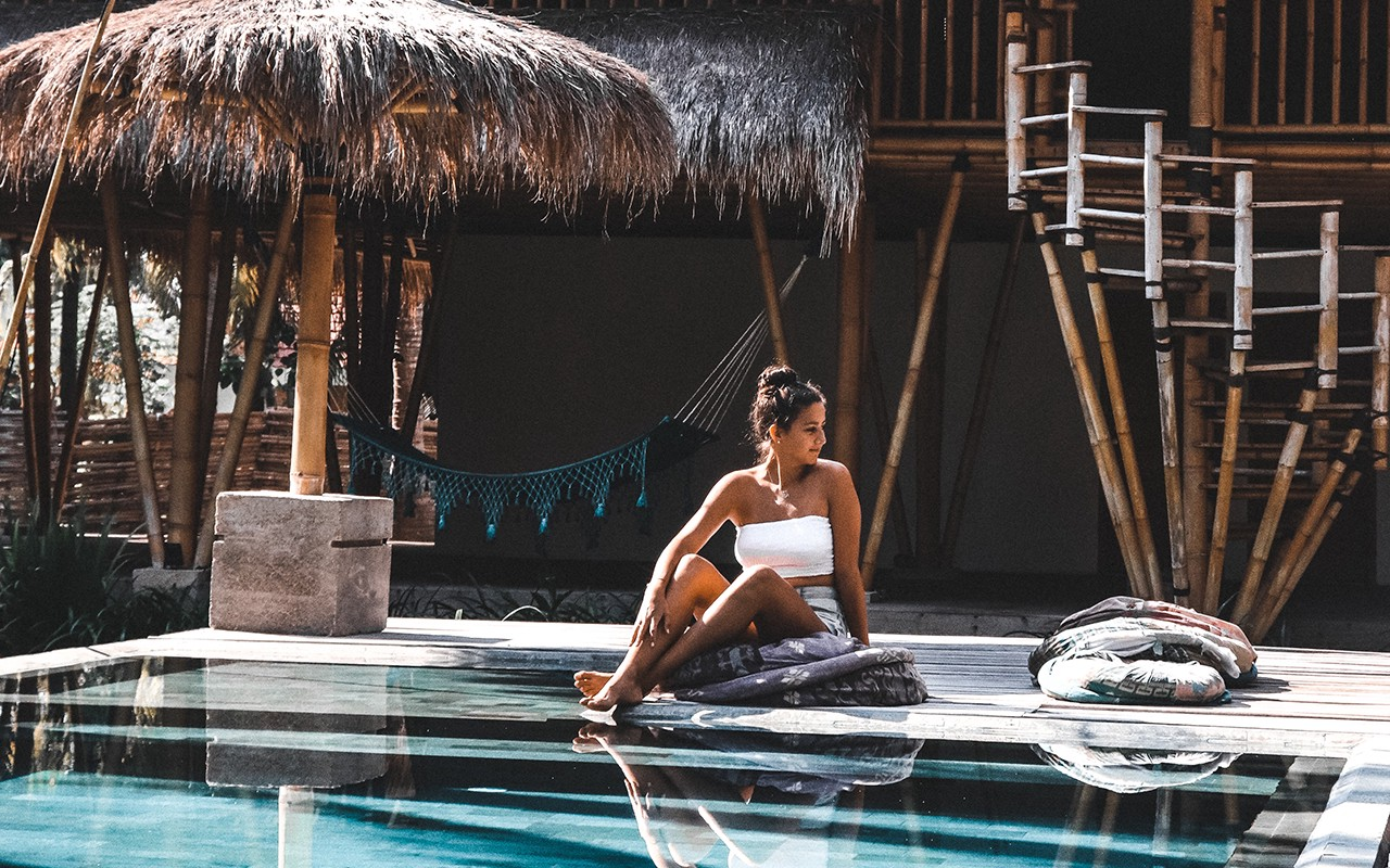 Woman sitting by the pool.