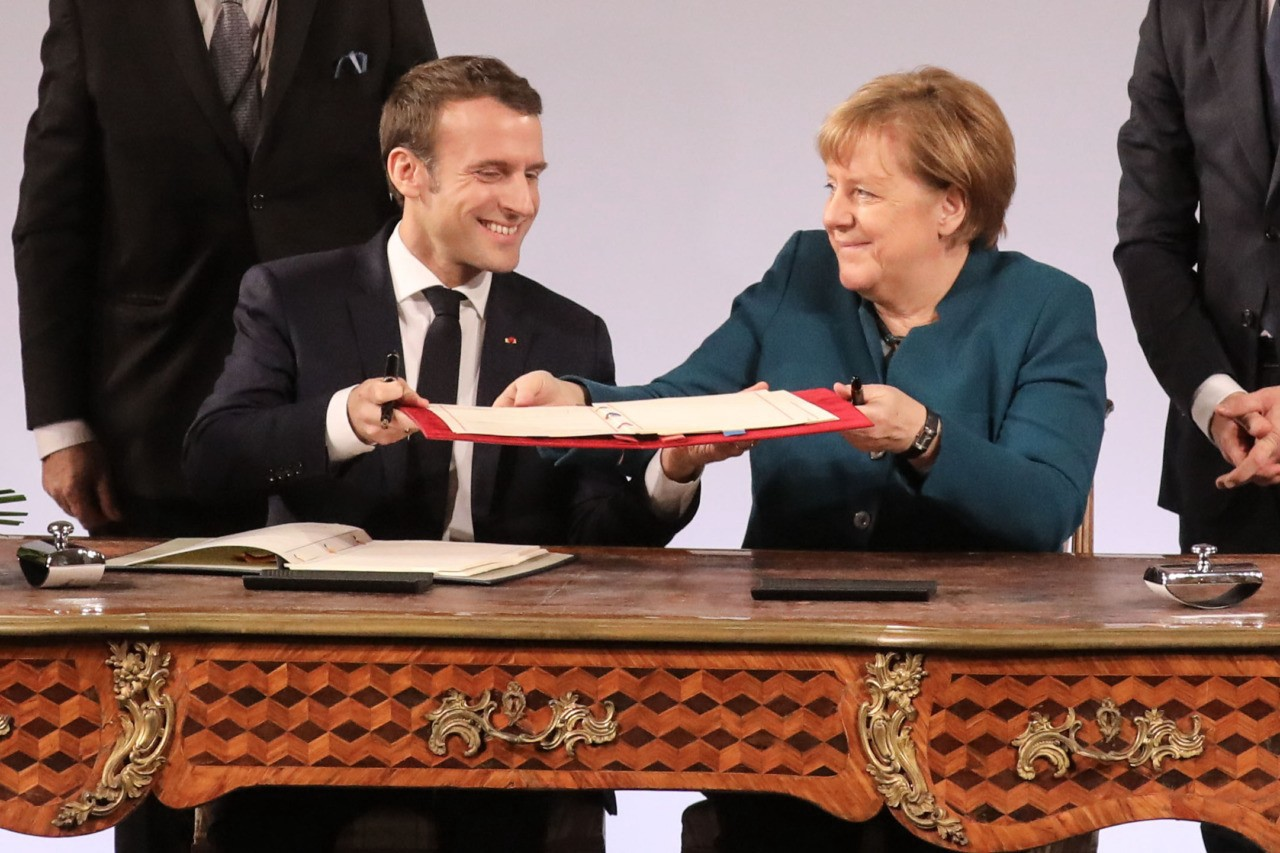 Germany's Chancellor Merkel and President Macron for France sign a foreign policy alignment treaty