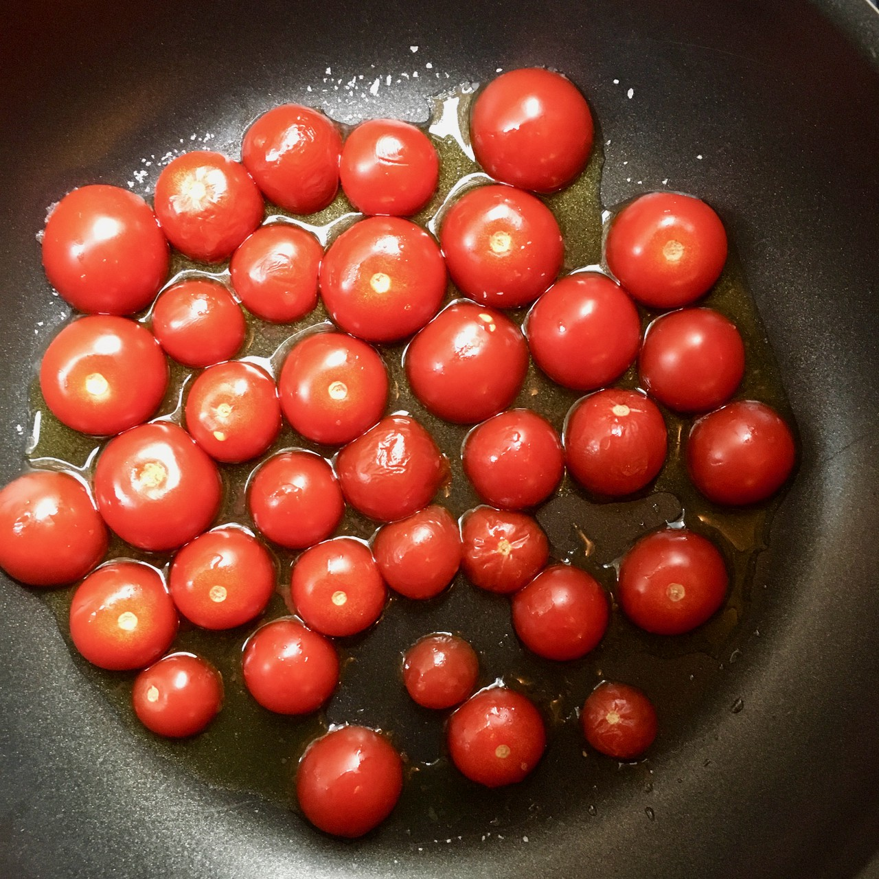 Cooked cherry tomatoes.