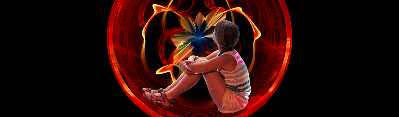 A child hugs their knees to their chest, photoshopped into a large, red and orange circular fractal.