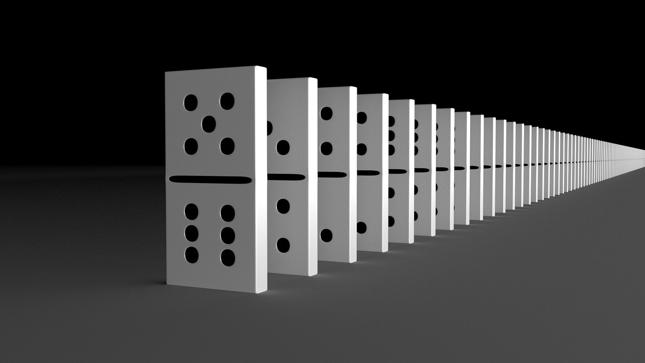 a chain of white dominoes on a black gradient background