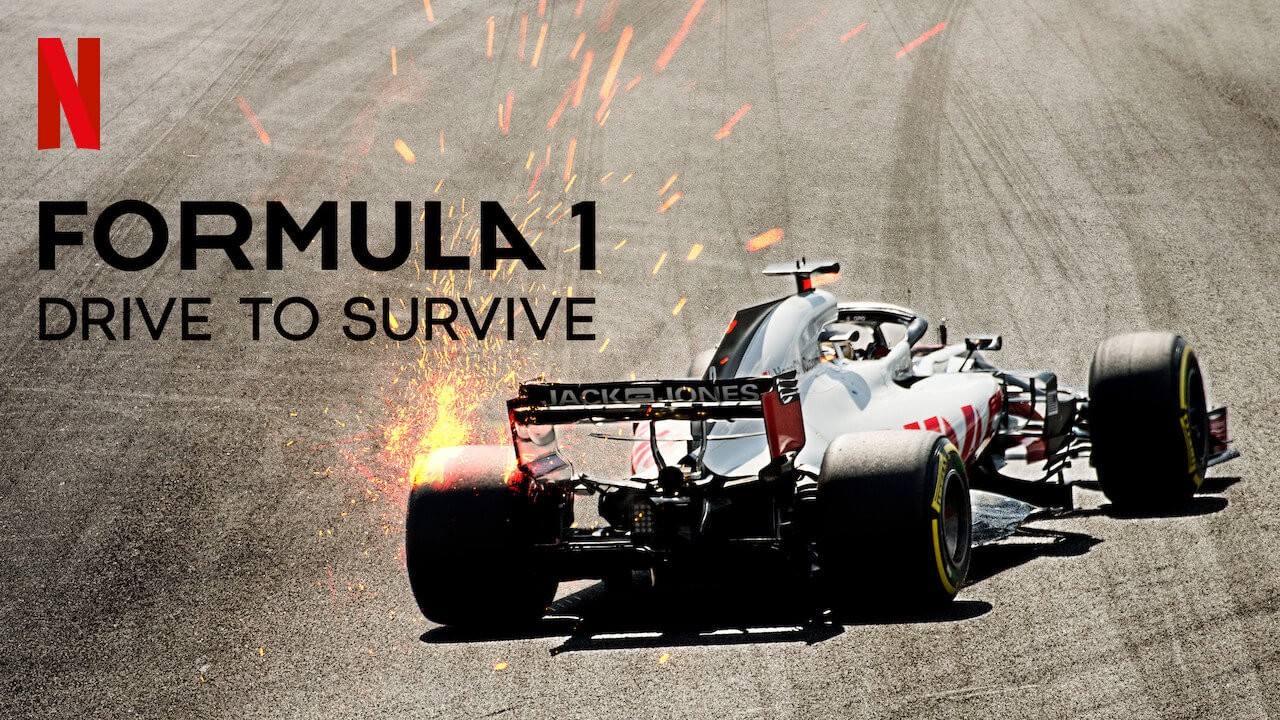 Cover image of Netflix Documentary series, Formula 1: Drive to Survive. This is an image of a white drag racing car making a sharp turn, creating sparks that are flying off its wheels.