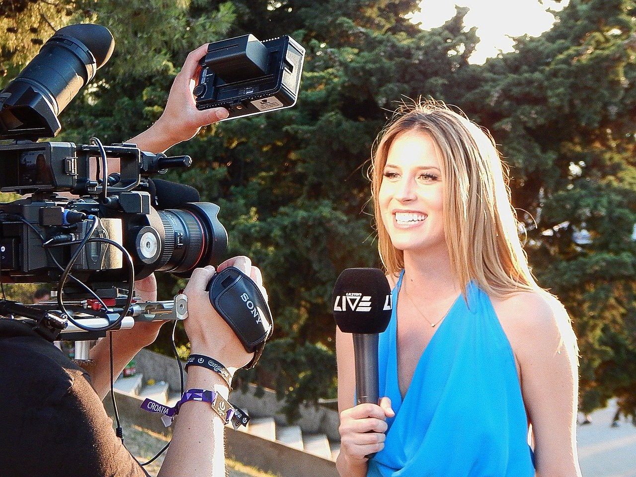reporter in front of camera