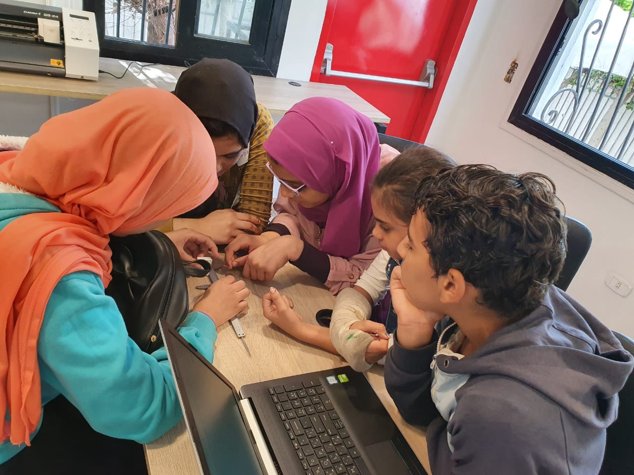 Five young students take measurements for a project.