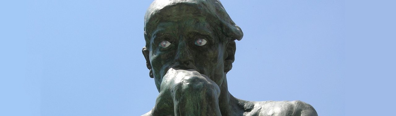 """Rodin's """"The Thinker"""" (a statue with its knuckles against its mouth in thought); lifelike eyeballs have been photoshopped on."""