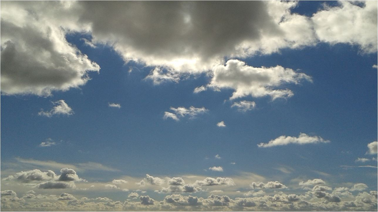 White clouds scattered amid a blue sky