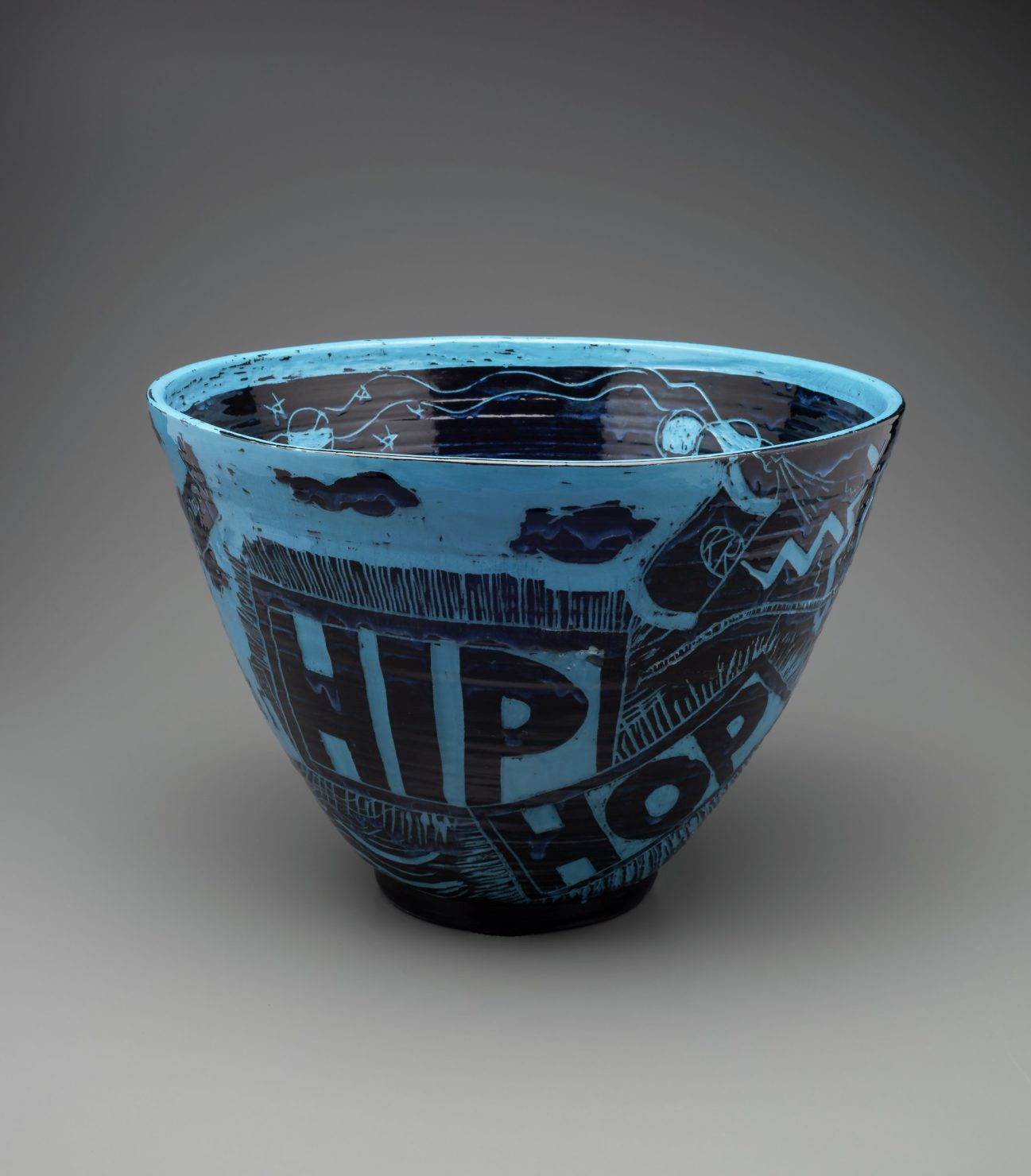 Black and blue ceramic bowl with words related to hip hop music in Atlanta.
