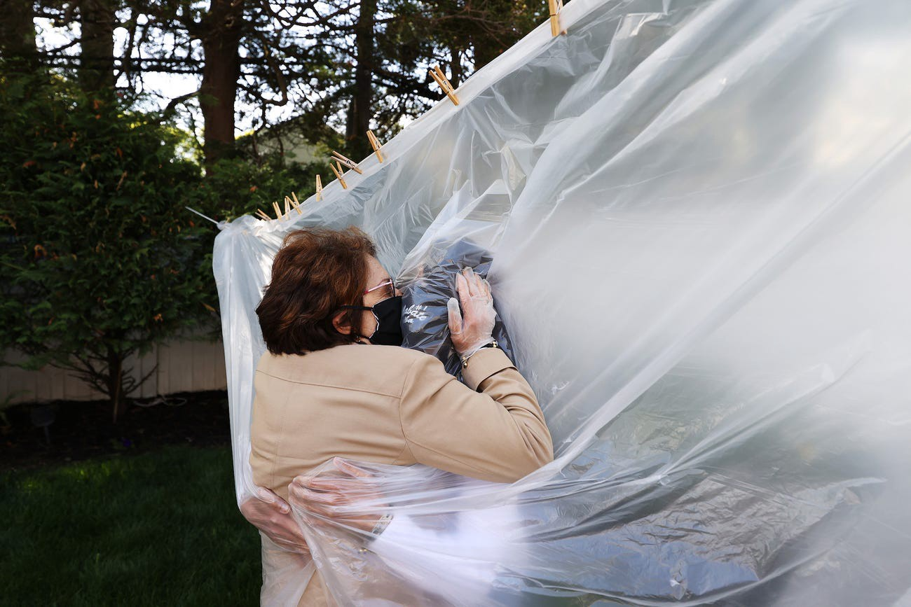 Michelle Grant hugs her mother, Mary Grace Sileo, in Wantagh, New York, on May 24, 2020.