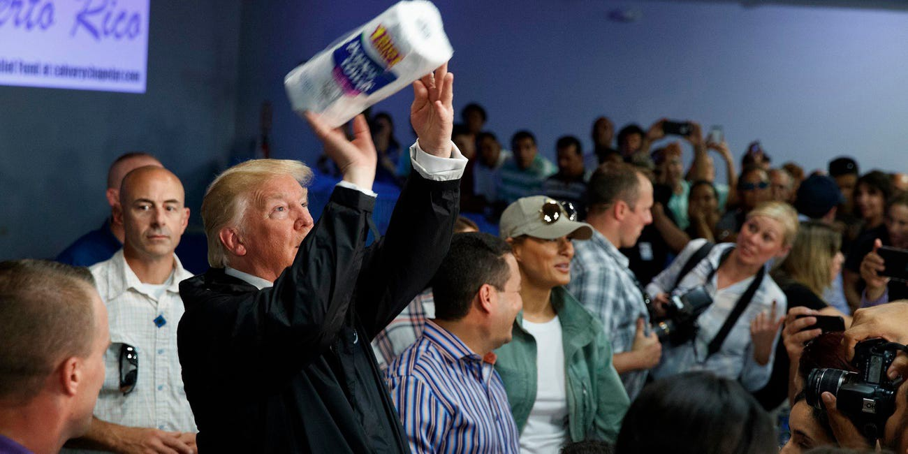 Trump tosses paper towels into a crowd at Calvary Chapel in Guaynabo, Puerto Rico.