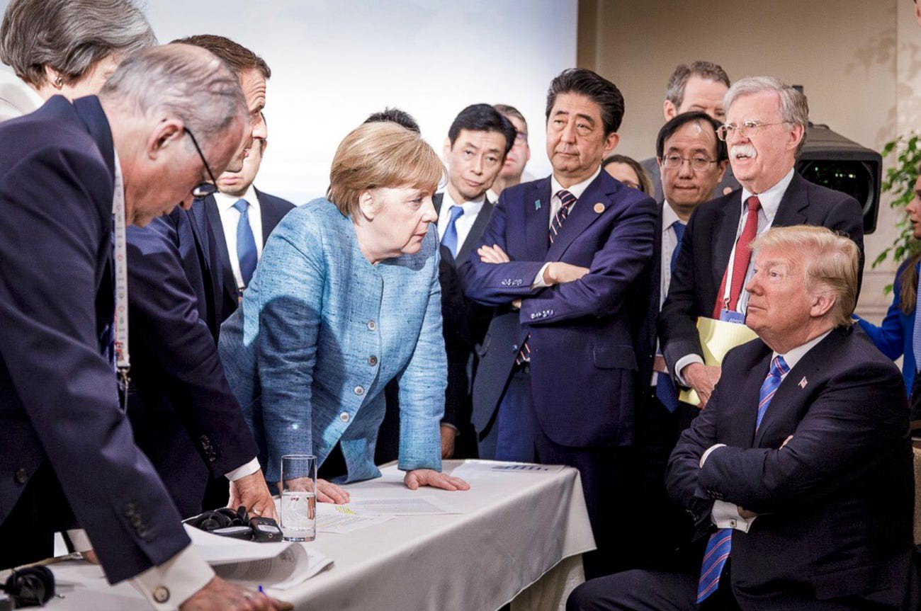 Angela Merkel, center, speaks with Donald Trump during the G7 Leaders Summit in La Malbaie, Quebec, Canada, on June 9, 2018.