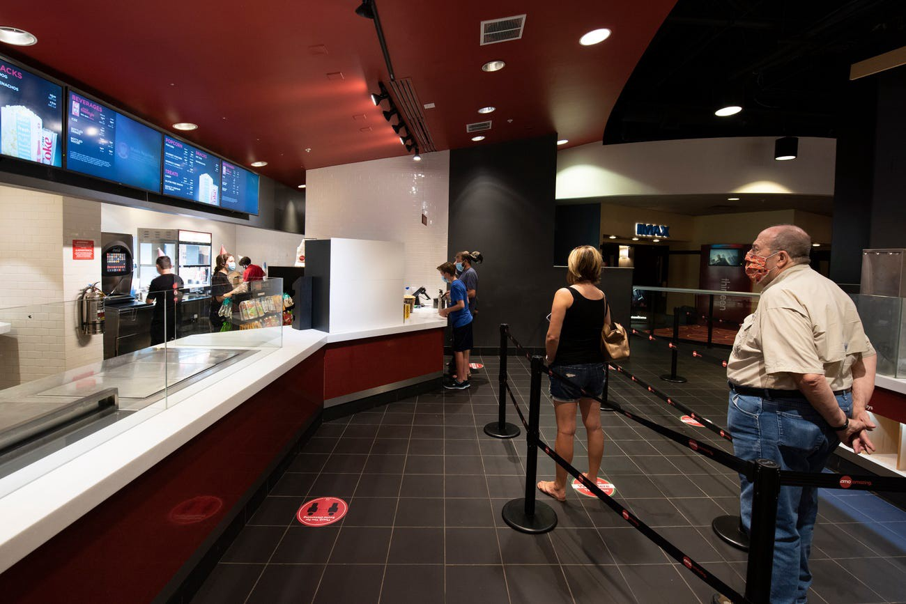Moviegoers at the AMC Highlands Ranch 24 in Highlands Ranch, Colorado, on August 20.
