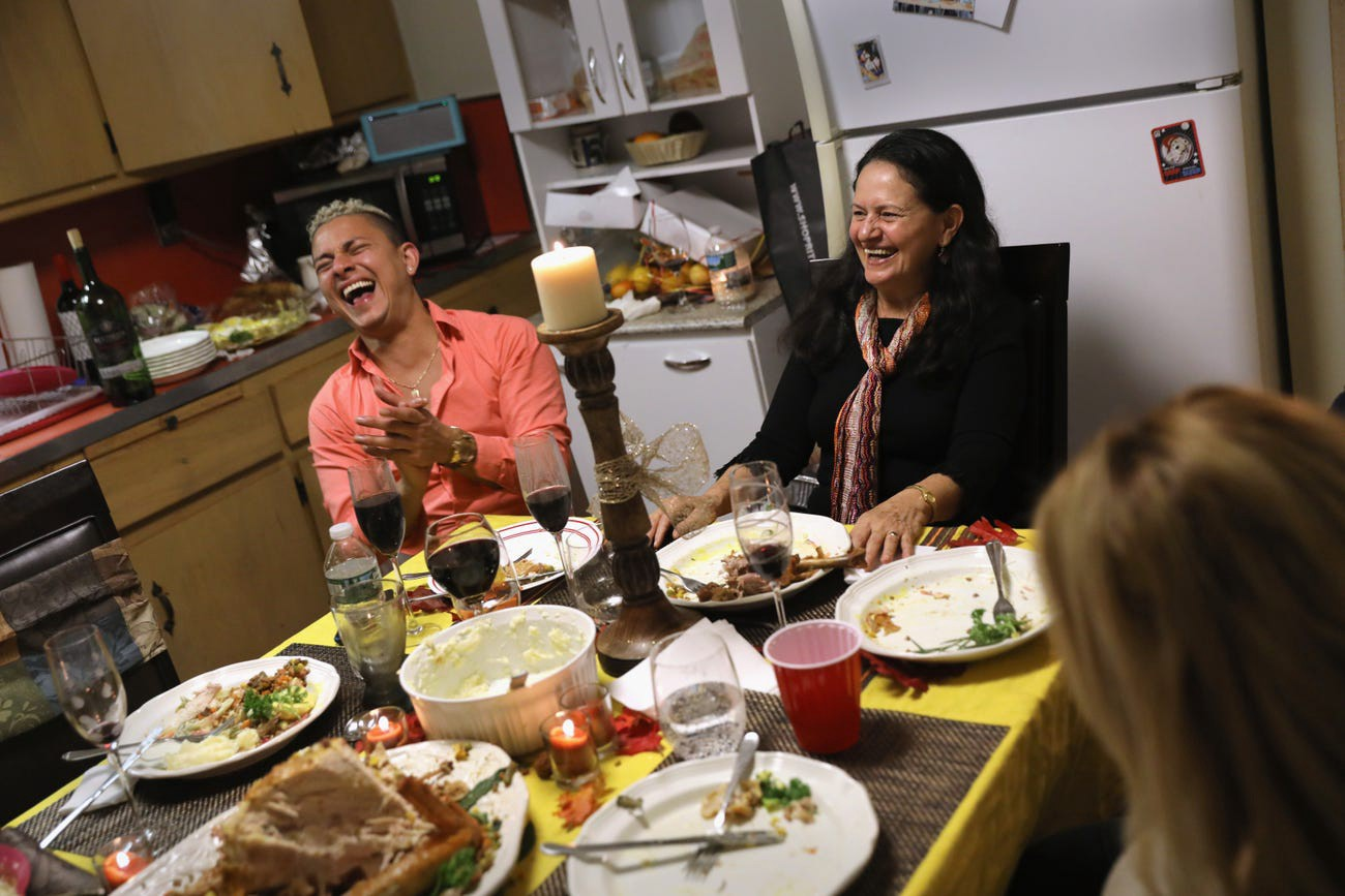 A family celebrates Thanksgiving on November 24, 2016, in Stamford, Connecticut.