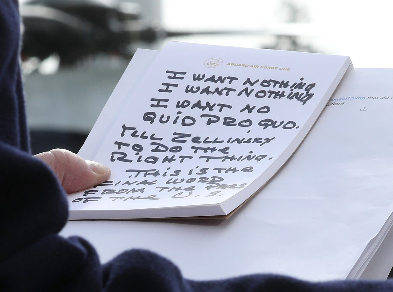 Donald Trump holds his notes while speaking to the media about the impeachment inquiry hearings.