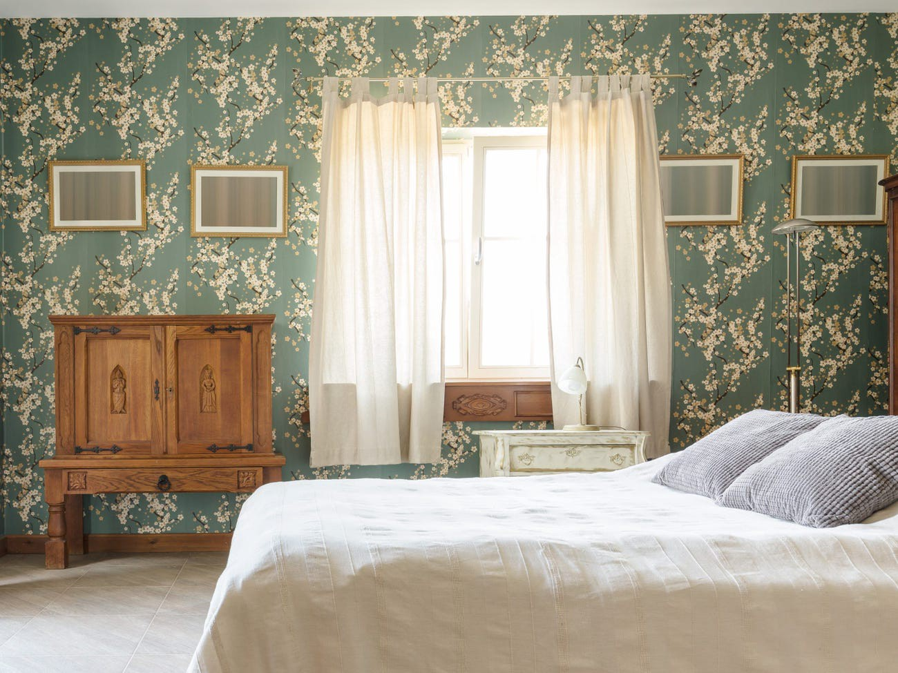 A bedroom with peel-and-stick wallpaper.