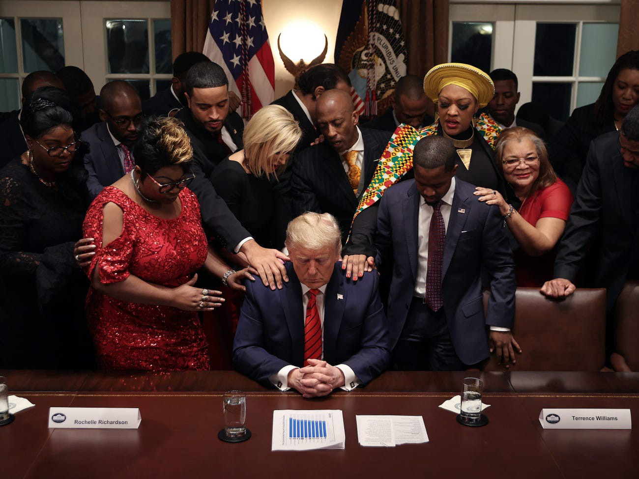 African American supporters pray for President Donald Trump on February 27, 2020.