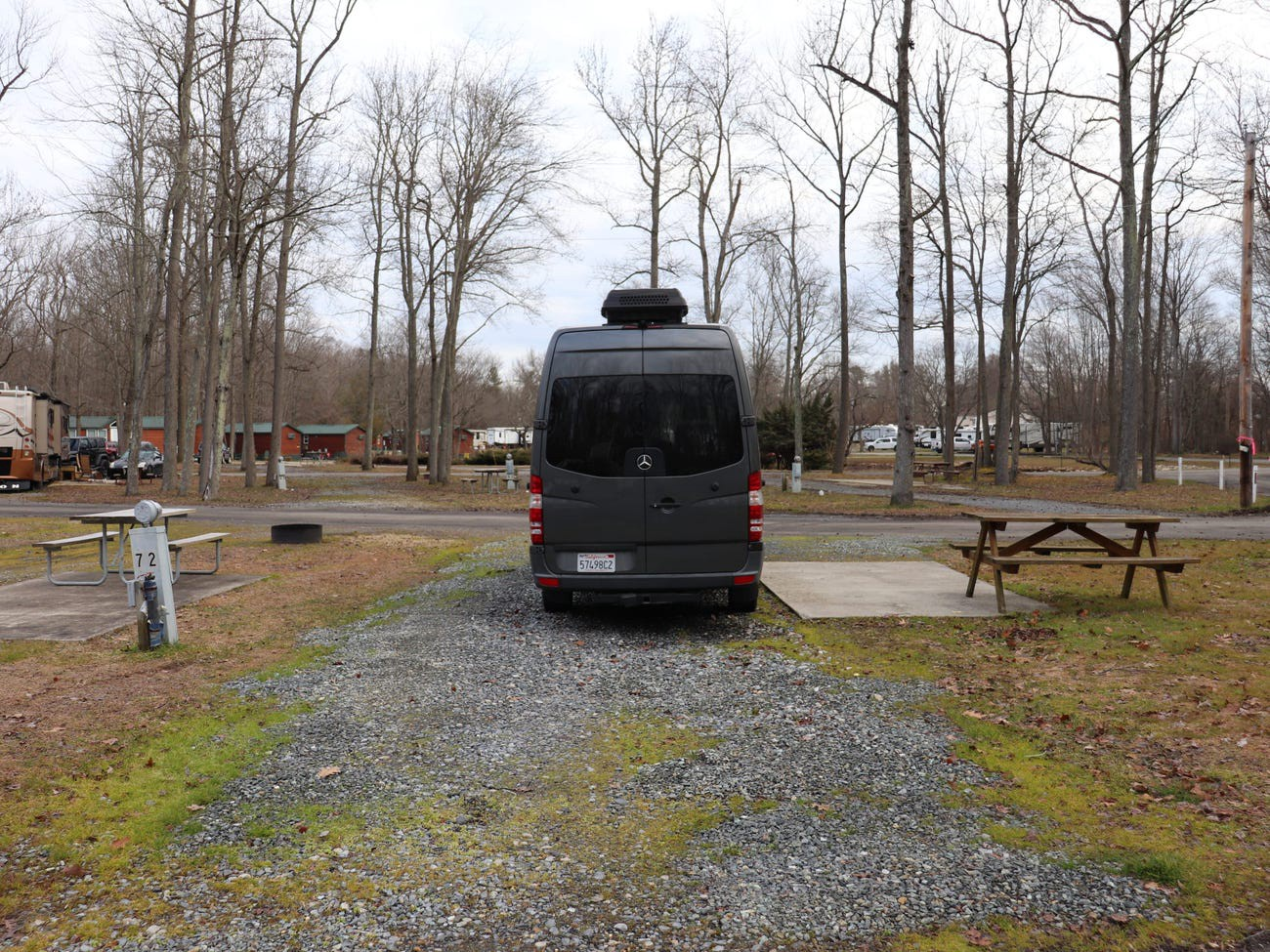 The camper van parked at a campground.