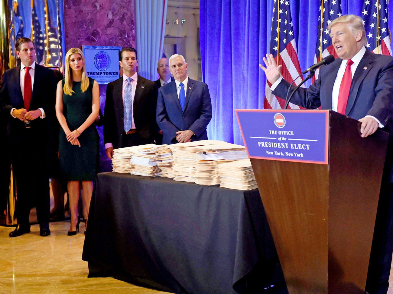 Eric Trump, Ivanka Trump, Donald Trump Jr, and Vice President-elect Mike Pence look on as President-elect Donald Trump conducts a press conference at Trump Tower in New York on January 11, 2017.