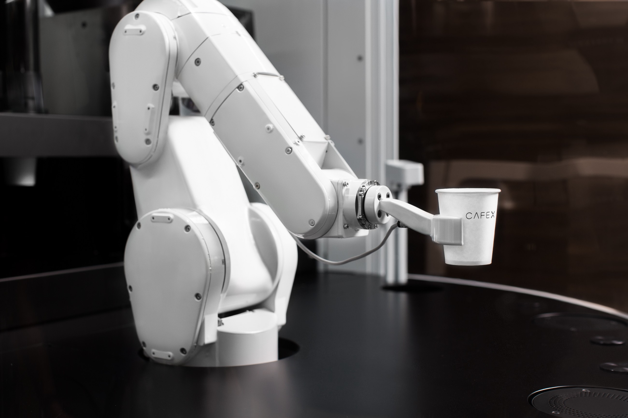 Robot arm holding a cup of coffee