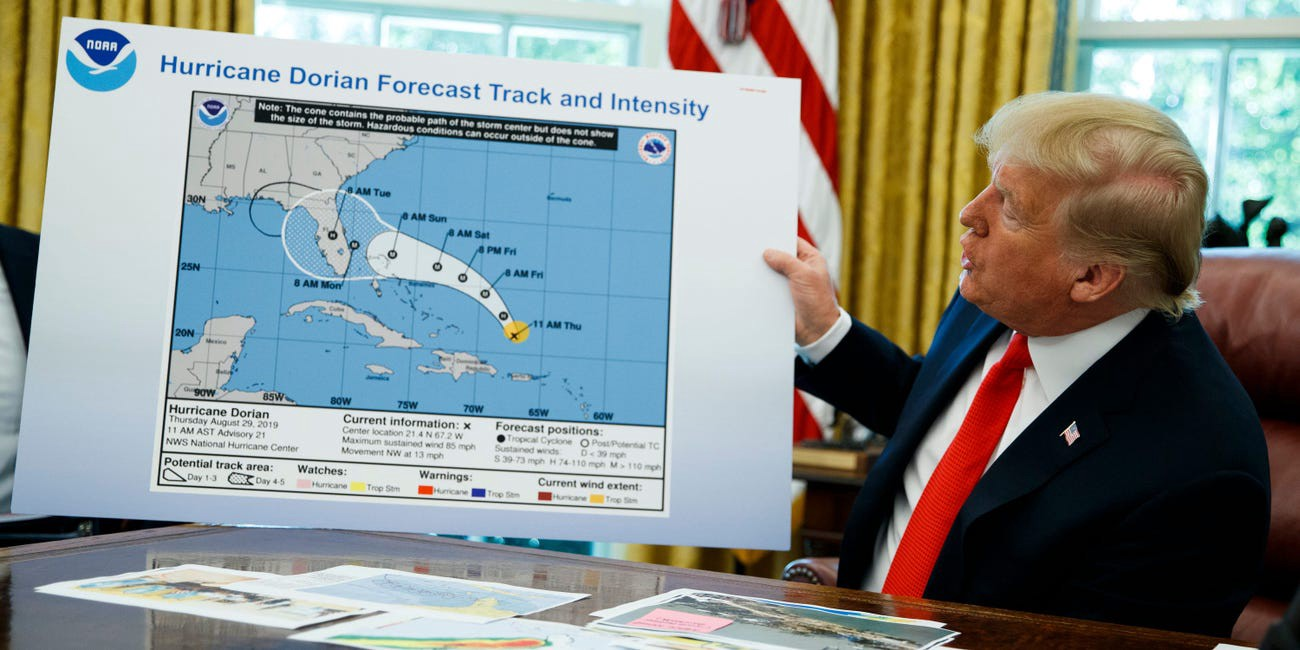 Donald Trump holds a chart at the White House after receiving a briefing on Hurricane Dorian on September 4, 2019.