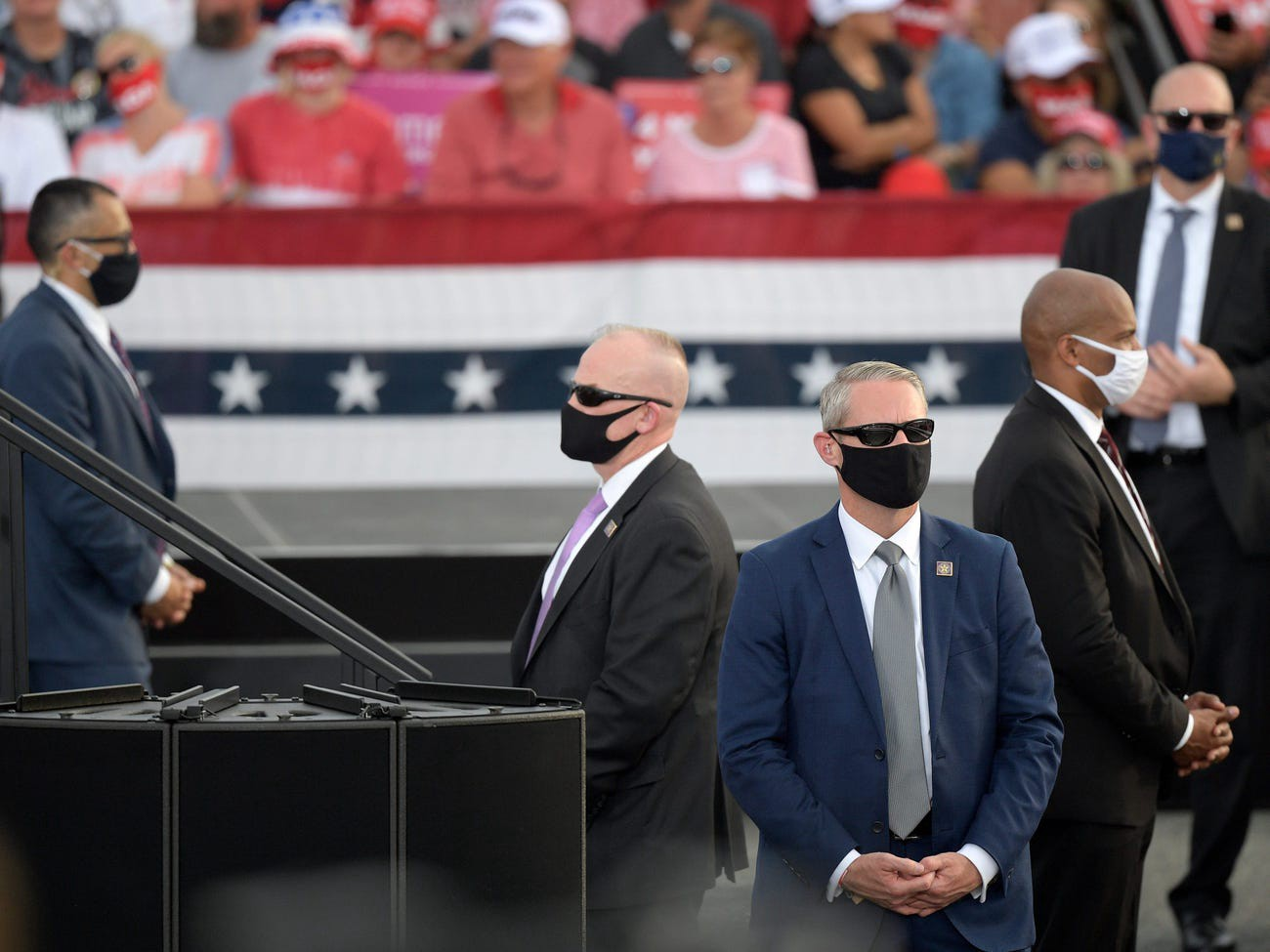 Secret Service agents watch the crowd as President Donald Trump addresses supporters in Florida.