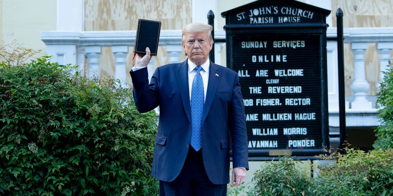 Donald Trump holds a Bible while visiting St. John's Church in Washington, D.C.