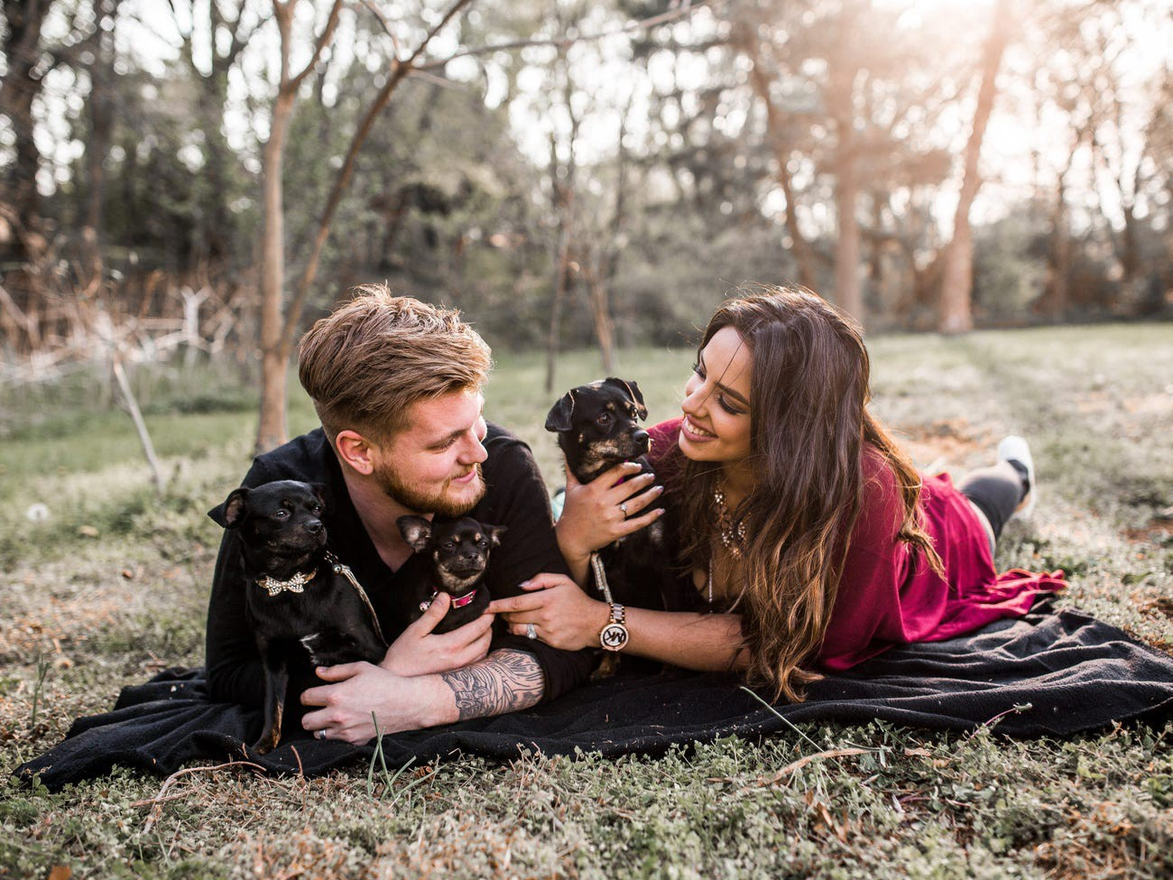 Kirsten, Devin, and their three dogs.