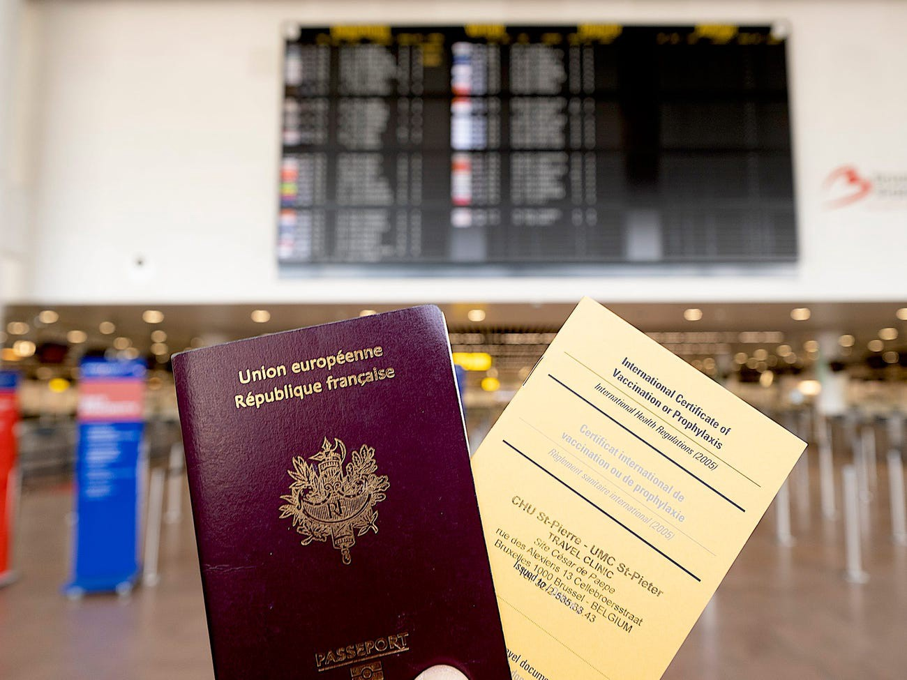 A French passport and an International Certificate of Vaccination.
