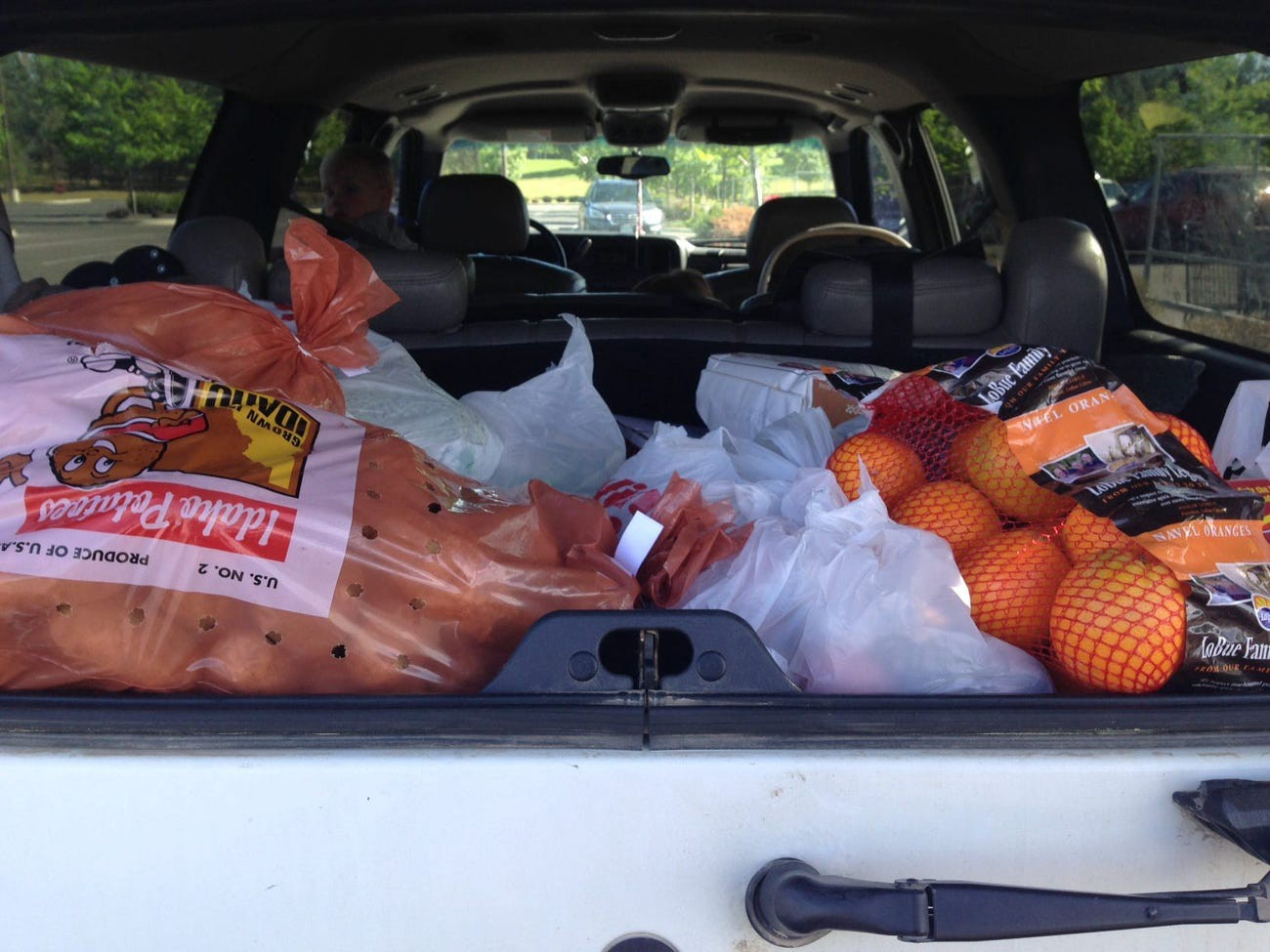 A car trunk full of groceries.