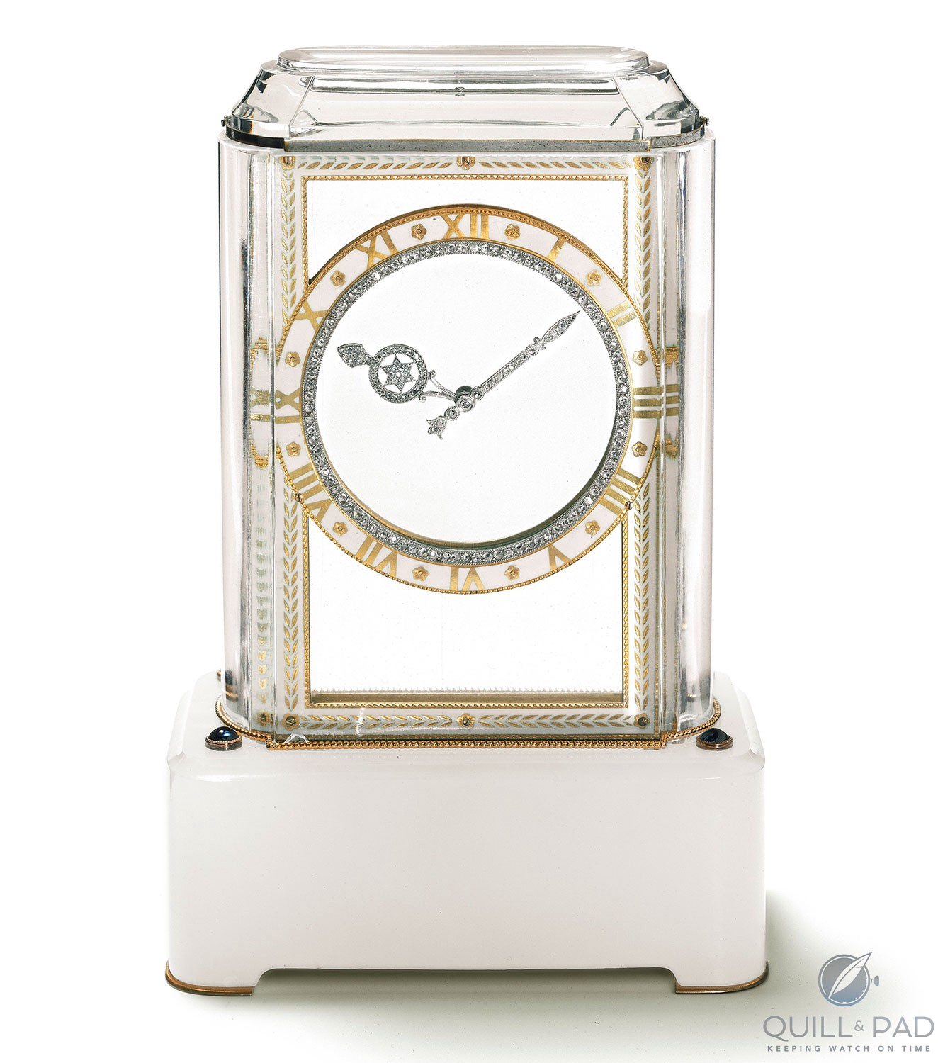 Model A Cartier Mystery Clock from 1912 featuring platinum, gold, white agate, rock crystal, sapphires, rose-cut diamonds, enamel
