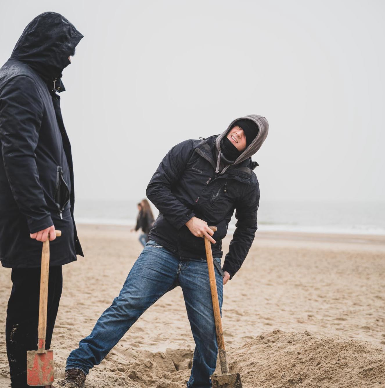 Jonas and Hannes building a sandcastle in cold weather