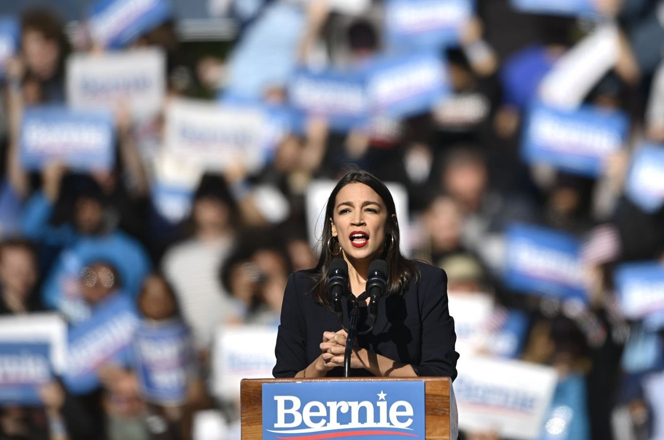 Rep. Alexandria Ocasio-Cortez speaks to a crowd of supporters for Sen. Bernie Sanders during a campaign rally on Oct. 19 in New York City.