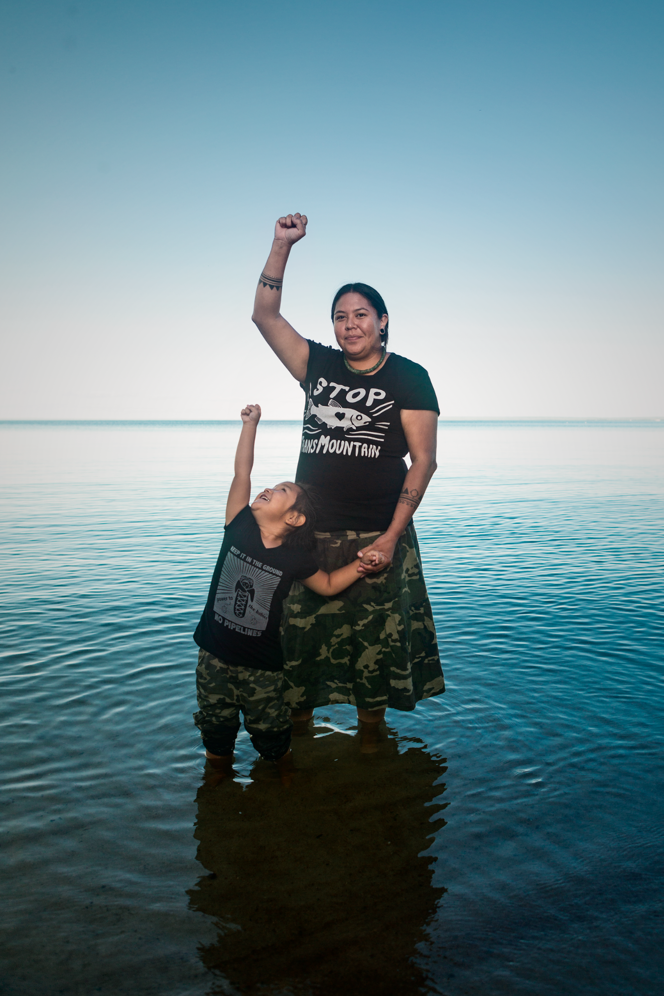 Portrait of Snutetkwe Manuel (Secwepemc First Nations) pictured with her daughter at Cold Lake, Alberta.