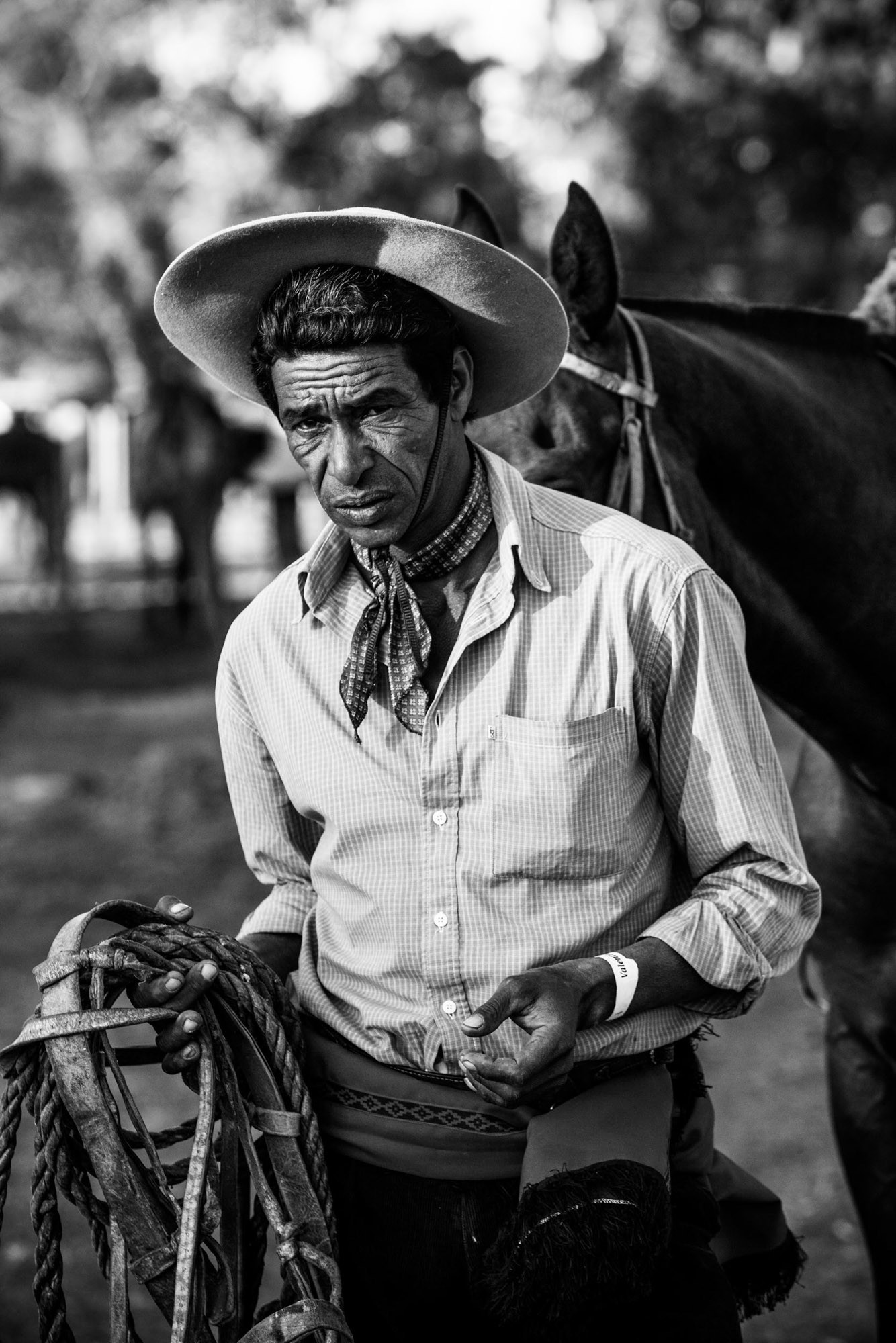 This gaucho made a new set of reins and lariat from cowhide for one of the regional criollas, or rodeo gatherings that draw competitors from every part of Uruguay on weekends. ©James Fisher 2017 All Rights Reserved