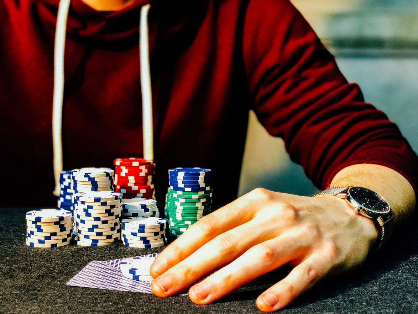 Placing a bet with cards and piles of chips.