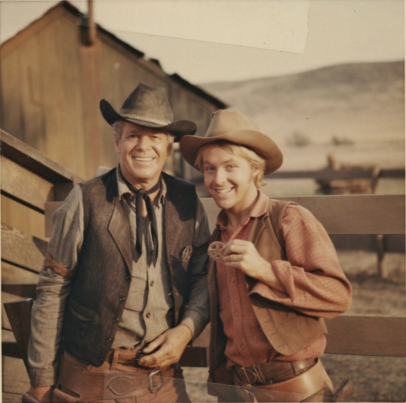 """Dan Duryea and Michael Parks joke around in this behind the scenes candid from the 1967 NBC western """"Stranger on the Run"""""""