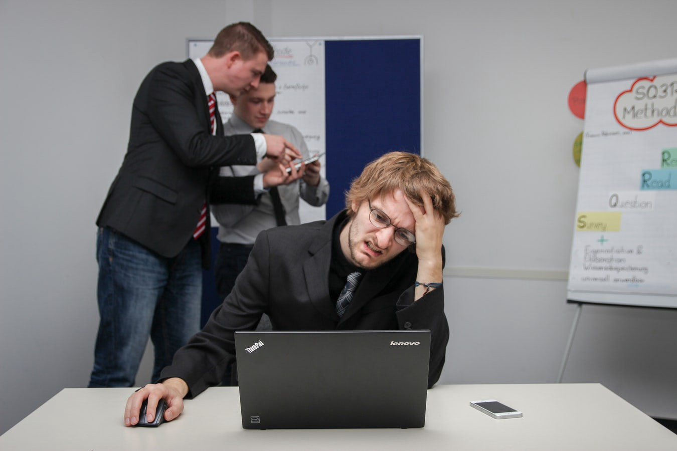 team member who is looking at the computer and is stressing over tasks