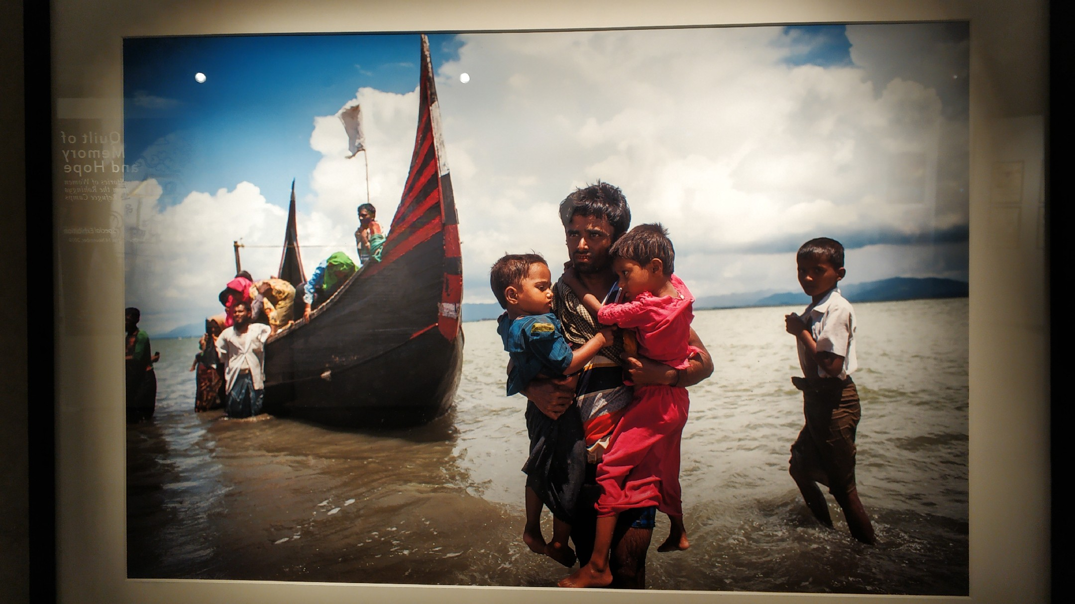 """Picture of refugees at sea from the exhibition """"Photos of Rohingya Exodus"""""""