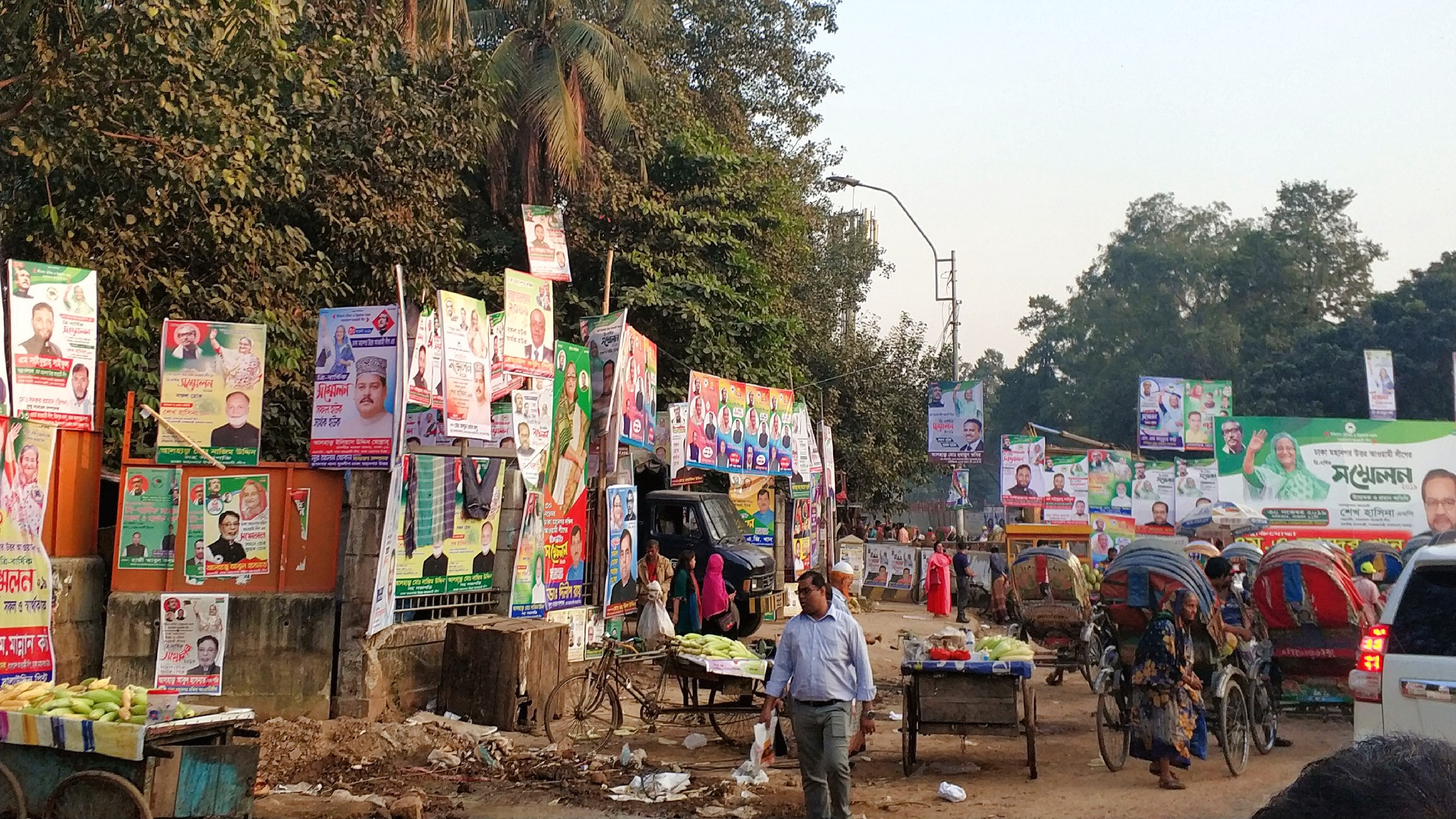 political posters and traffic in Dhaka