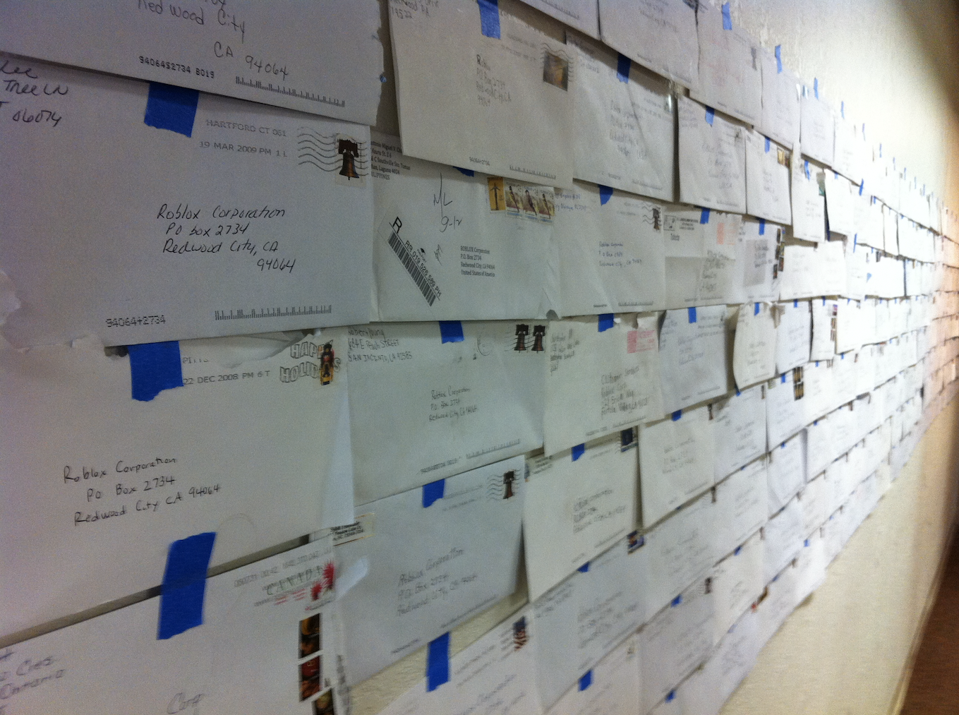 A wall lined with letters from young Roblox fans