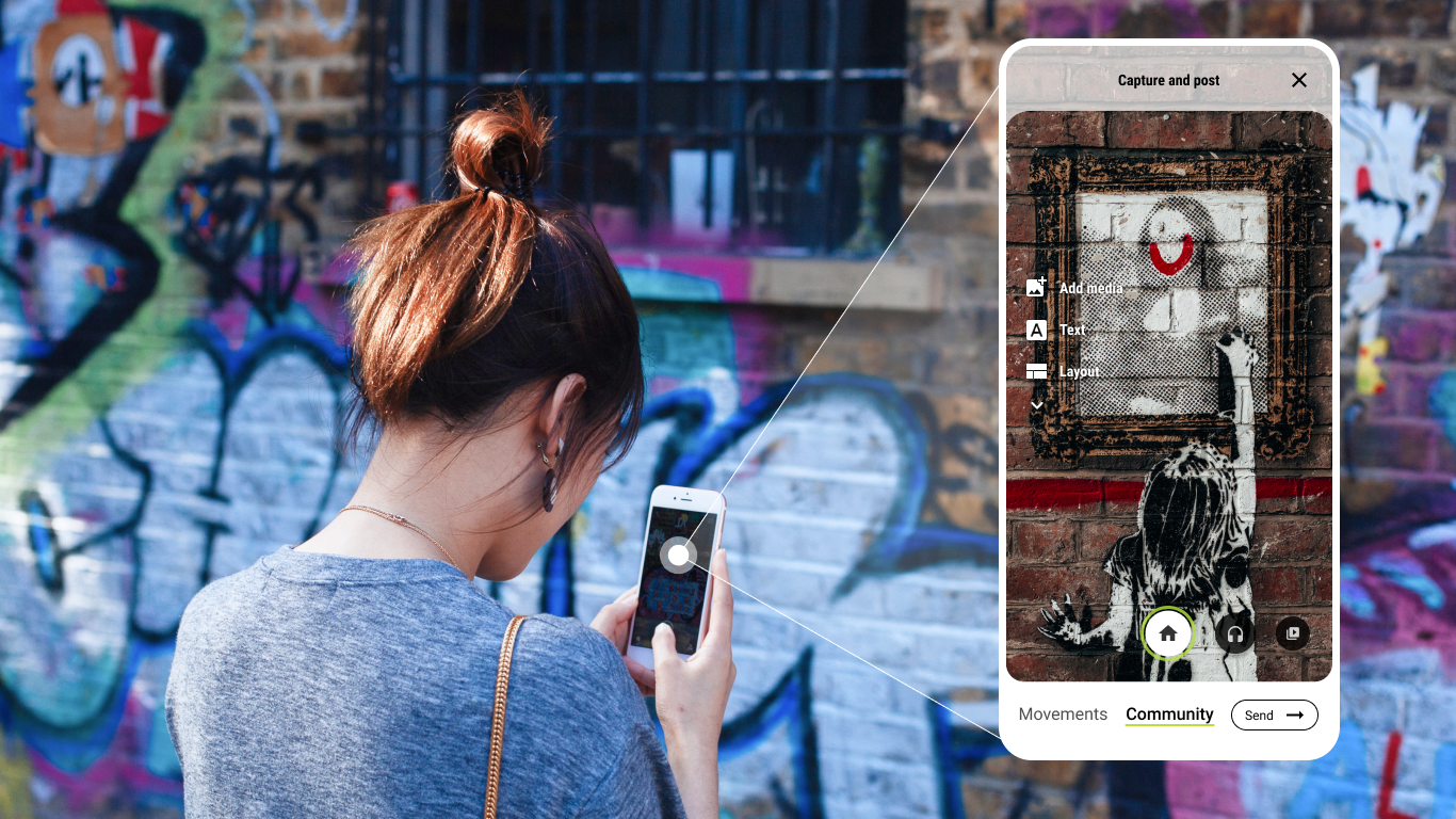 Woman taking a picture of Banksy's graffiti on her phone and posting it to the community in the Sojourn app