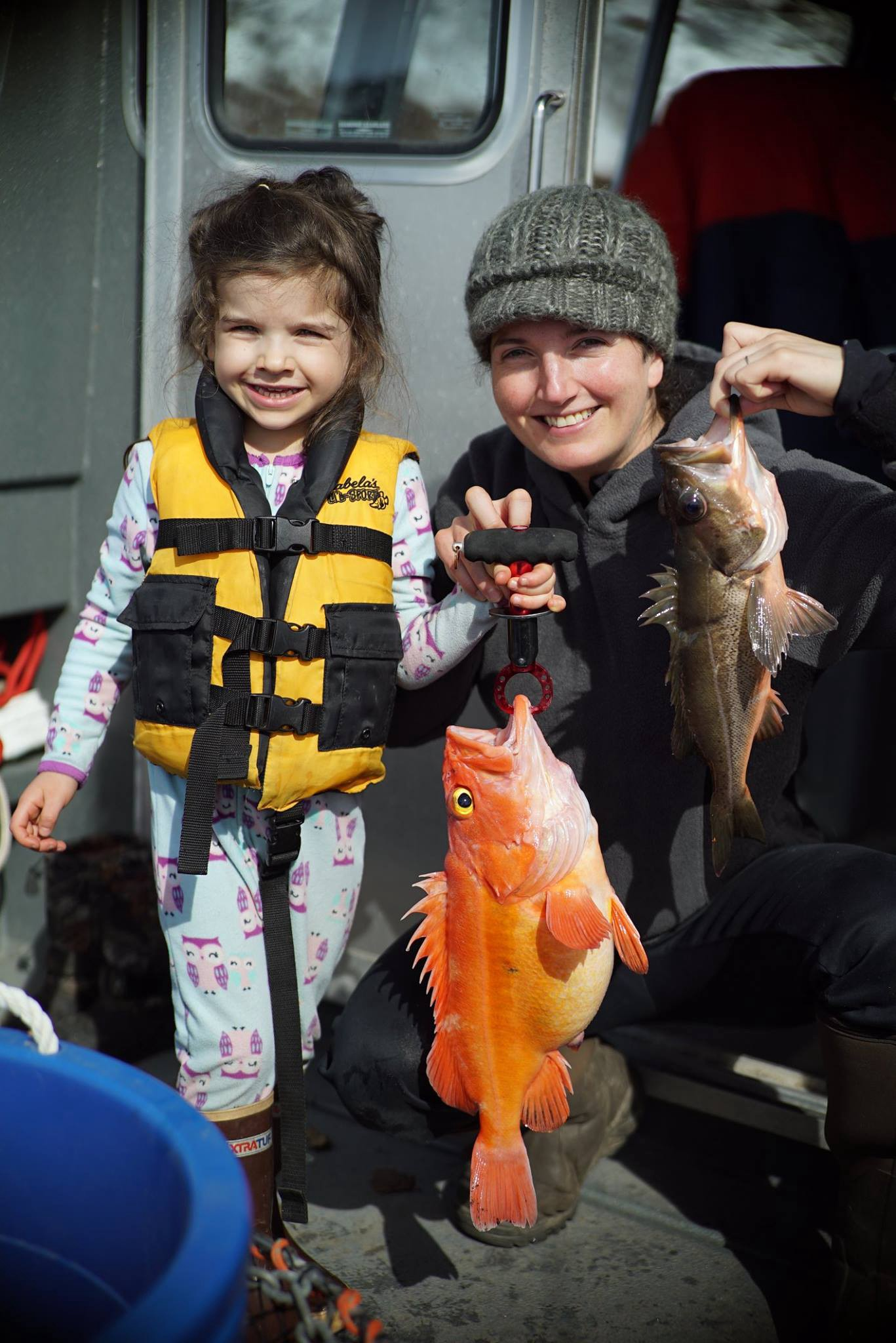 woman with a kid and 2 rockfish