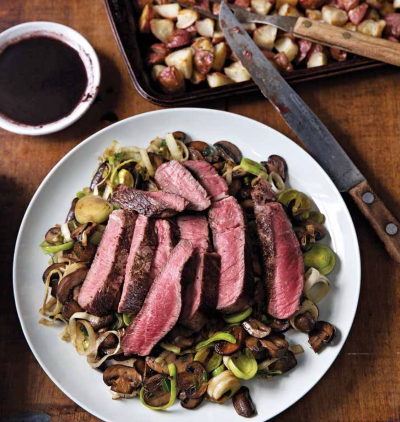 Steak slices on sauteed Brussels sprouts and sliced mushrooms.