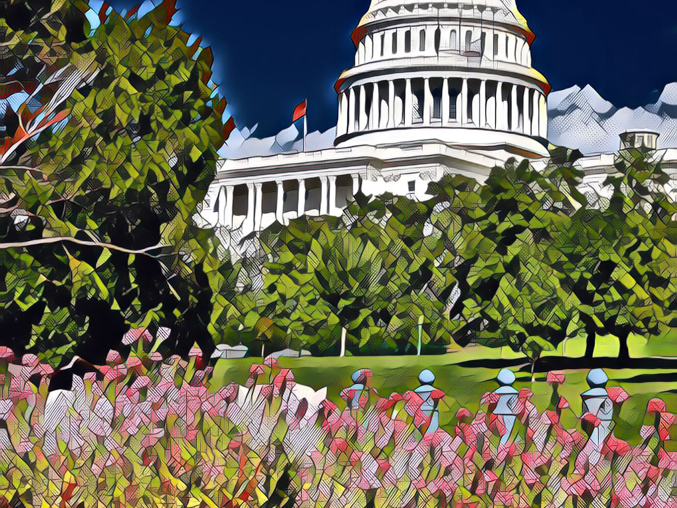 A view of the United States Capitol in spring, with flowers in the foreground and trees in the middle.