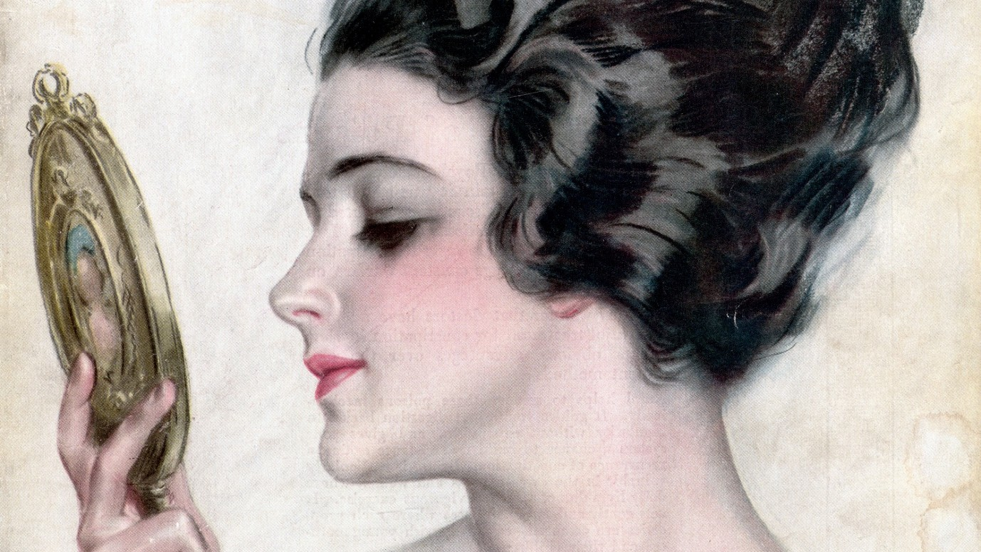 A young woman admires her face in a mirror. Cosmopolitan Magazine Cover.