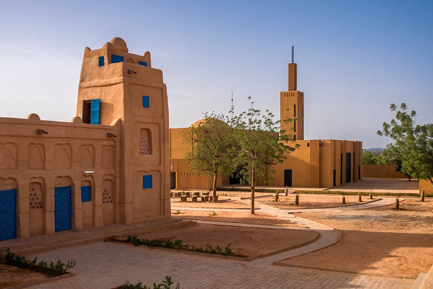 The Hikma: Religious and Secular Complex includes a 1,000-person mosque with worship spaces, a library, classrooms, reading and studying spaces, and a garden. The firm involved local women in the design process, resulting in additional rooms for literacy courses, meetings, and workshops. (Photo: p92, The Ideal City)